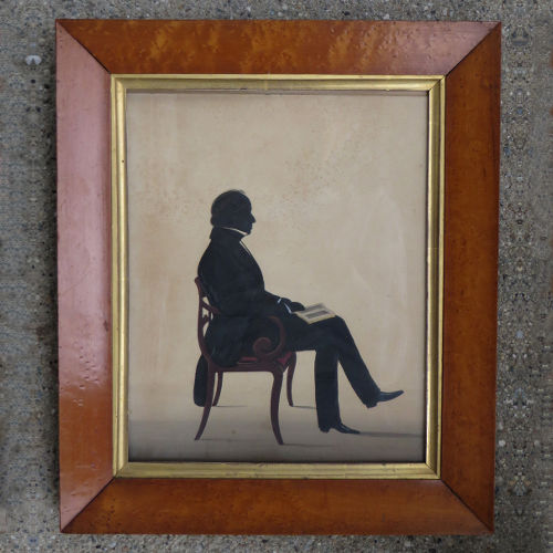 Silhouette of a Seated Man